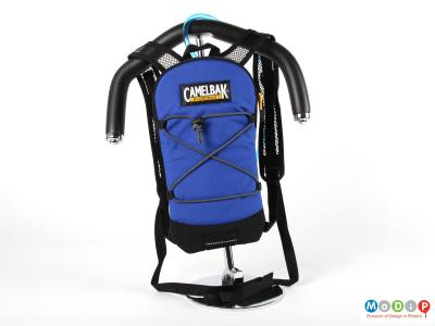 Front view of a Camelbak showing the bag hanging on a shoulder form.