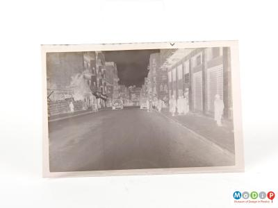 Front view of an album of negatives showing one of the negatives.