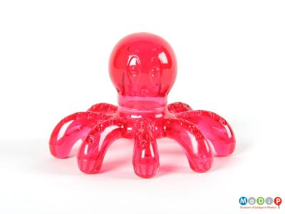 Front view of a massager showing the face of the octopus.