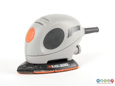 Side view of a Black and Decker Mouse showing the oval shaped black grip on the side and the orange on / off switch on the front.