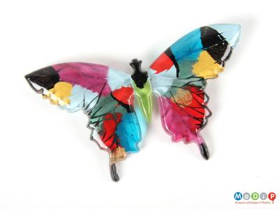 Front view of a butterfly brooch showing the shape of the wings and body.