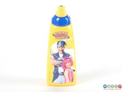 Front view of a Lazy Town bottle showing the adhesive label on the front depicting two characters from the programme.