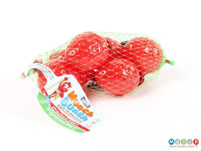 Side view of Squashums packaging showing the strawberry shapes in a net.