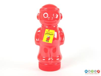Front view of a Jelly Babies jar showing the features of the figure including ears, nose, arms and legs.