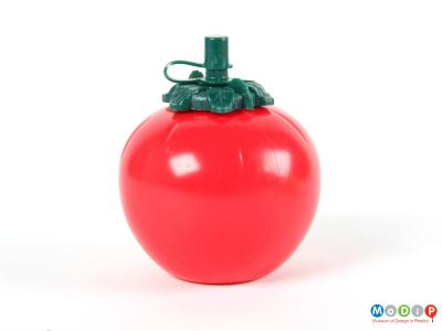 Side view of a tomato sauce bottle showing the spherical shape.