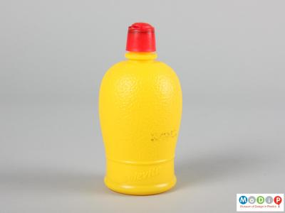 Side view of a lemon juice bottle showing the moulded texture in the body.