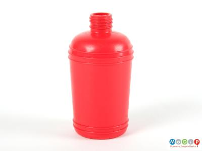 Side view of a red syrup bottle showing the moulded banding decoration.