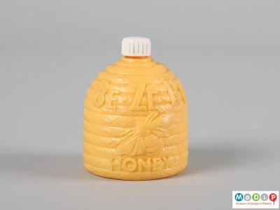 Front view of a Be Ze Be Honey bottle showing the moulded inscription and bee.