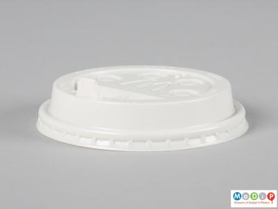 Side view of a hot drink lid showing the stright sides and flexible seal.