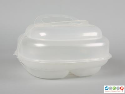 Side view of a Mash bento box showing the different layers and the carrying strap in place.
