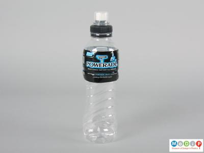 Side view of a Powerade bottle showing the moulded grip in the body.