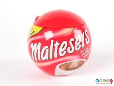 Side view of a Malteser jar showing the spherical shape and red lid.