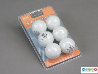 Front view of a set of table tennis balls showing the six balls in their packaging.