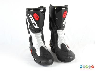 Front view of a pair of boots showing the shin plates and toe sliders.