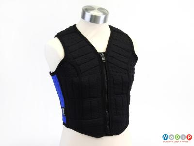 Front view of a running vest showing the zip closure down the centre.
