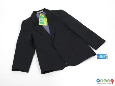 Front view of a jacket showing the lapels and front patch pockets.