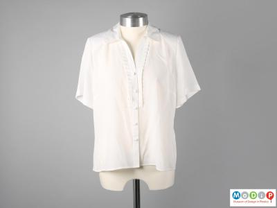 Front view of a blouse showing the button fastening.