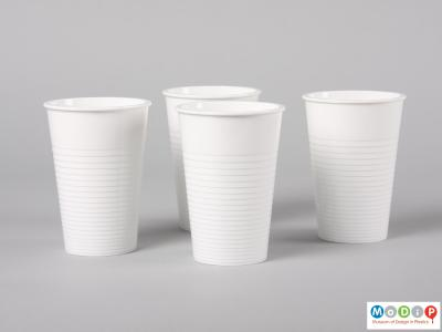 Side view of a set of Water tumblers showing the four beakers standing together.