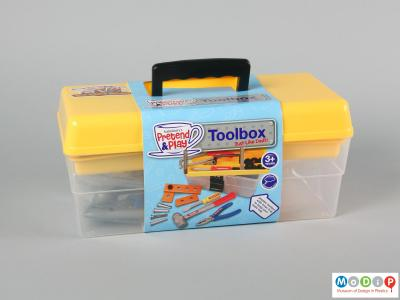 Front view of a toy tool box showing the packaing slip around the box.