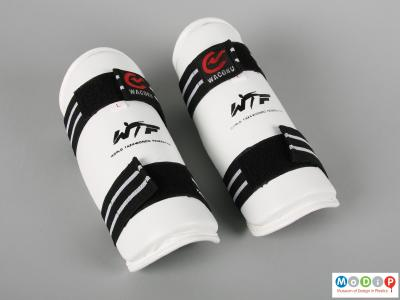Front view of a pair of arm protectors showing the velcro strapping.