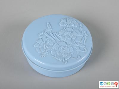 Top view of a powder pot showing the moulded cornflower decoration in the lid.