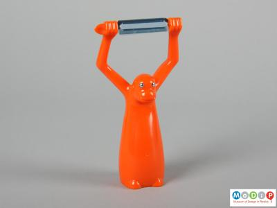Front view of a vegetable peeler showing the up stretched arms.