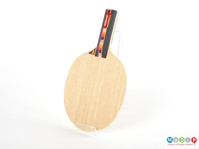 Front view of a table tennis blade showing the rounded paddle and straight handle.