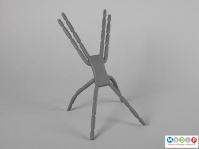 Front view of a device stand showing the lower legs bent to make a firm base.