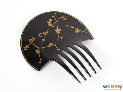 Top view of a comb showing the gold pattern.