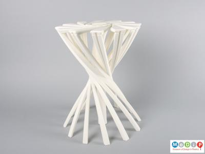 Side view of a stool showing it open.