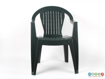Front view of a chair showing the round topped back rest.