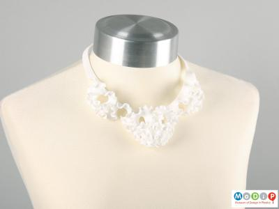 Front view of a necklace showing the ruffle design.