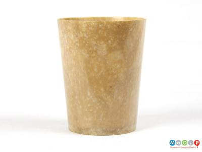 Side view of a beaker showing mottled material.