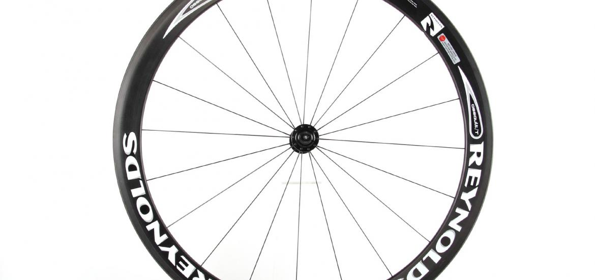 Side view of a bike wheel showing the deep set rim and the spoke pattern.
