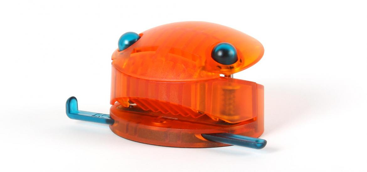 Front view of a hole punch showing the blue eyes.
