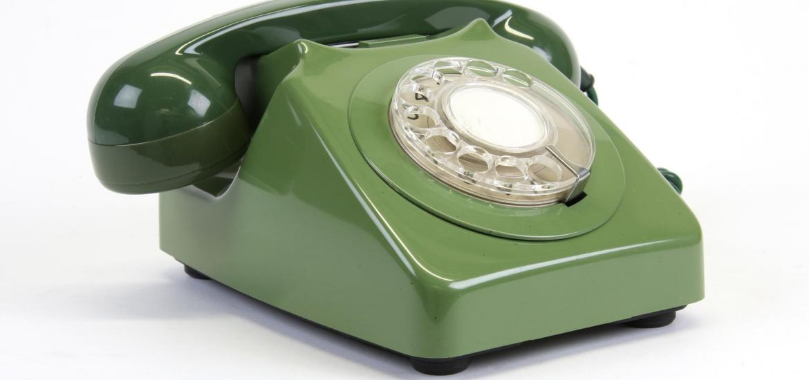 Front view of a telephone showing the dial.